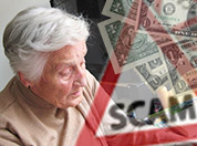 Elderly person with financial scam image in background.