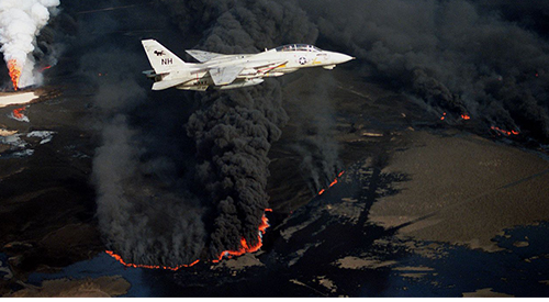 US Air Force plane flies over burning oil wells
