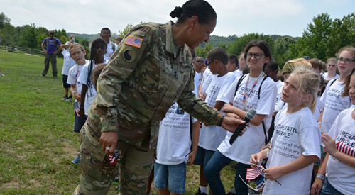 MD. Adjutant General Singhon talking to children during Military Experience Day.