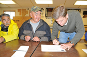 Signing of Letter of Intent by Mike Frueh and Joseph J. Lincoln, Head of the Nunakauyak Tribe in Alaska