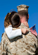 serviceman holding daughter